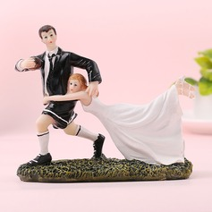 Sports Couple/Bride And Groom Resin Cake Topper (Sold in a single piece)