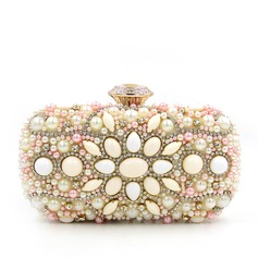 Refined Pearl Clutches